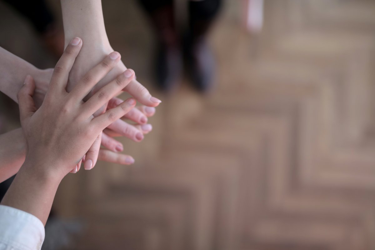 crop group stacking hands together 3830745